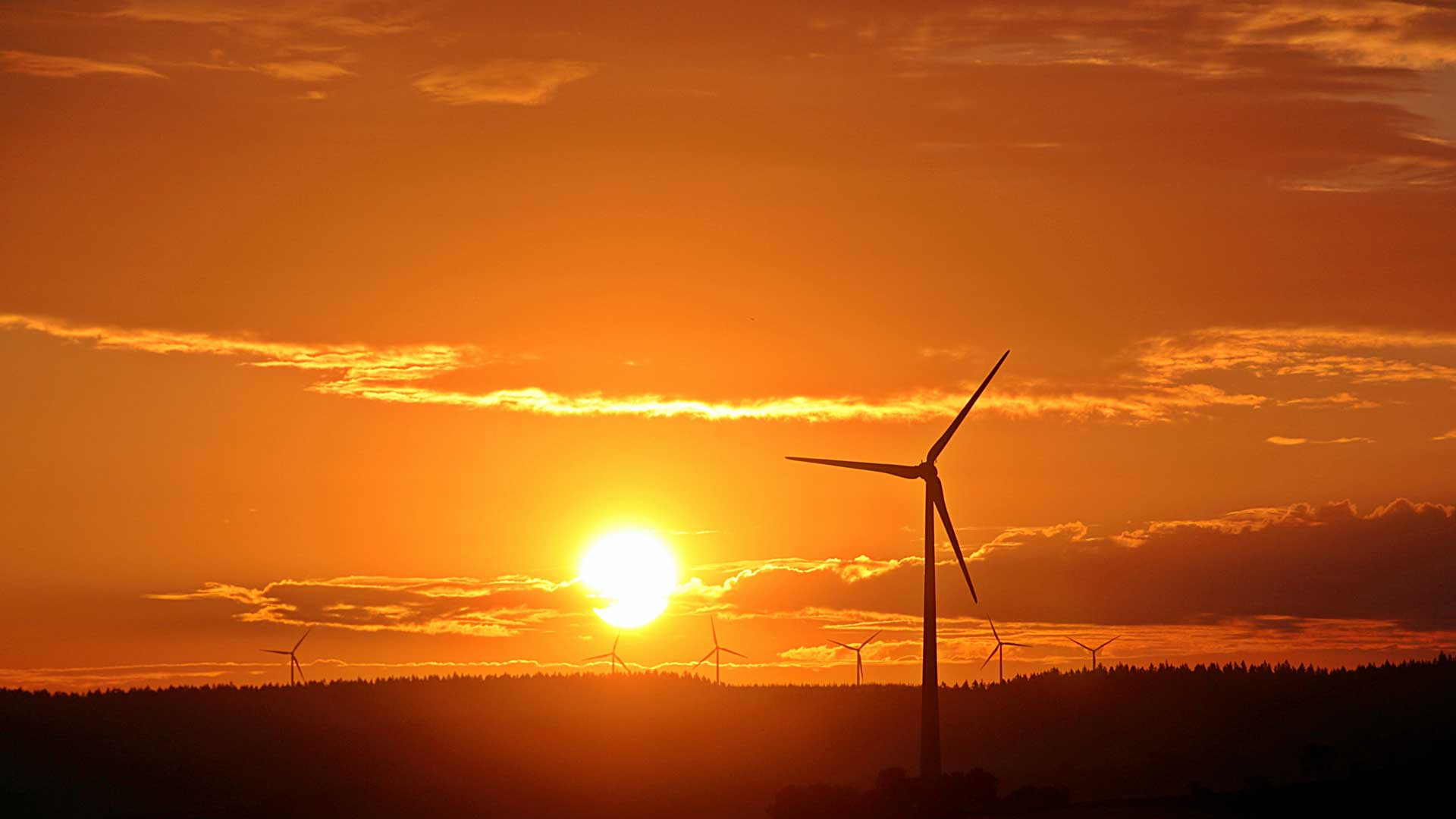 Sunrise and wind turbines silhouette